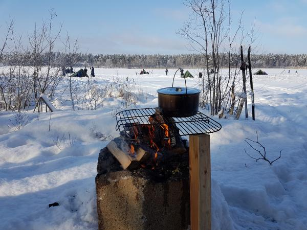 Pot over the fire, food tastes good when you are outside!